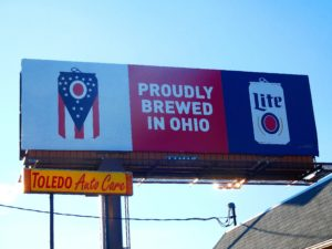 "A Miller Lite Billboard in Toledo proclaiming ""Proudly Brewed in Ohio"""